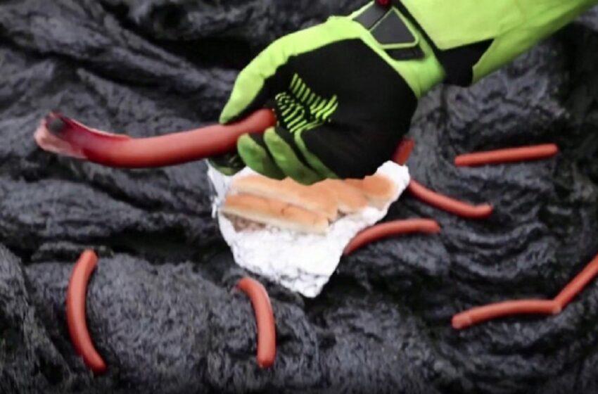 Imagini spectaculoase cu erupția vulcanului din Islanda: oamenii prepară cârnați pe lavă